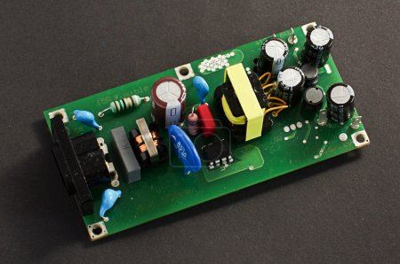 Photo for Printed circuit board PCB with components. Power source device. - Royalty Free Image