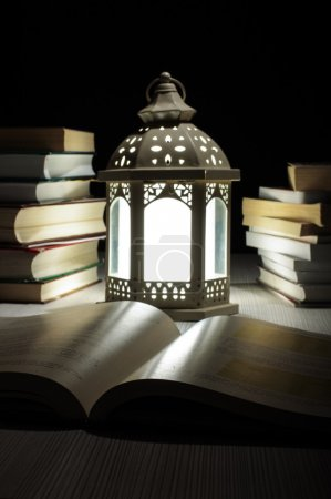 Lantern and many books late at night