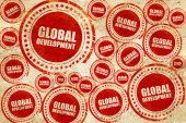 global development, red stamp on a grunge paper texture