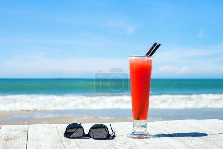 Cocktail and sunglasses on the beach