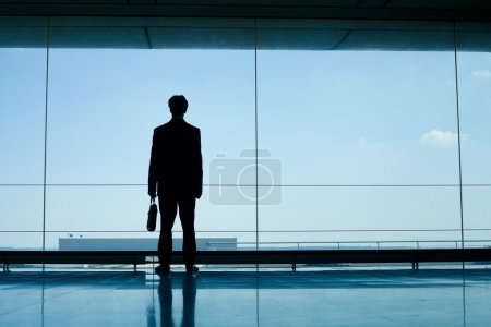 Silhouette of businessman waiting