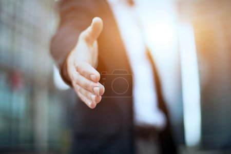 Business man offer partnership and giving hand...