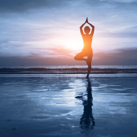 Photo for Wellness concept, beautiful silhouette of woman practicing yoga - Royalty Free Image
