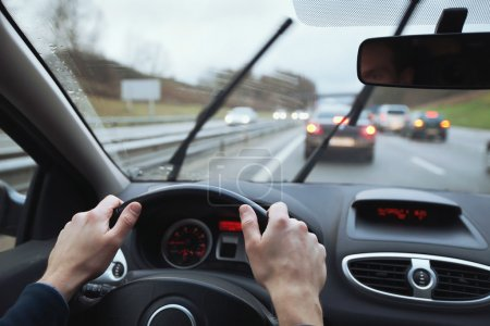 Photo for Driving in hard weather conditions, rain on the windshield - Royalty Free Image