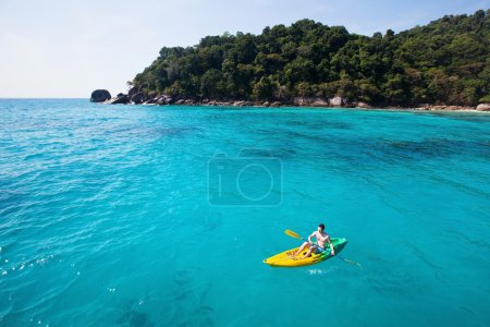 Kayaking on paradise beach