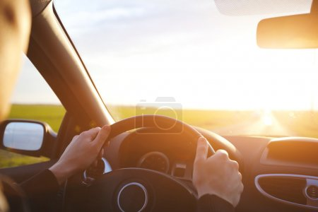 Photo for Man driving car on the empty road, travel background - Royalty Free Image