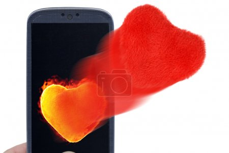 Photo for Blue smartphone and hot and soft hearts. Idea for Valentines Day messages, love, lovers, love apps, Internet, blogs and others. - Royalty Free Image