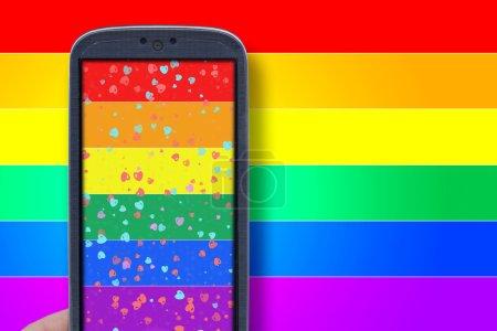 Photo pour Smartphone bleu et fond LGBT. Idée pour les messages de la Saint-Valentin, amour LGBT, amoureux, applications d'amour, Internet, blogs et autres . - image libre de droit