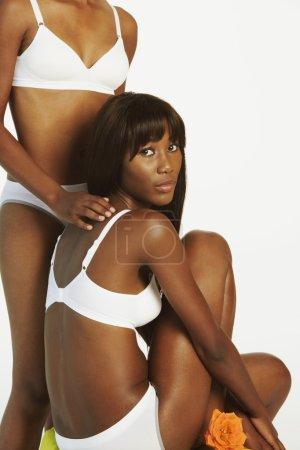 Two African women wearing underwear