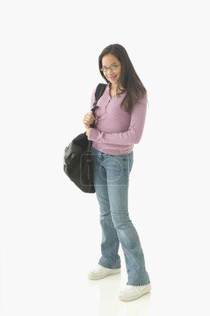 Teenage girl with book bag