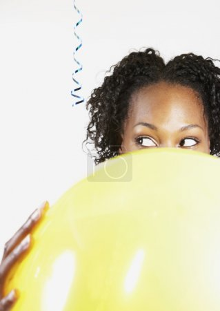 African woman holding balloon