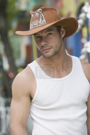 Hispanic man wearing cowboy hat