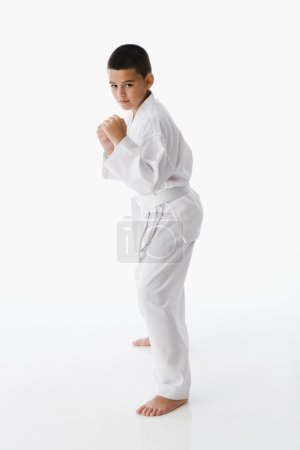 Hispanic boy in martial arts stance