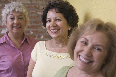 Three woman smiling