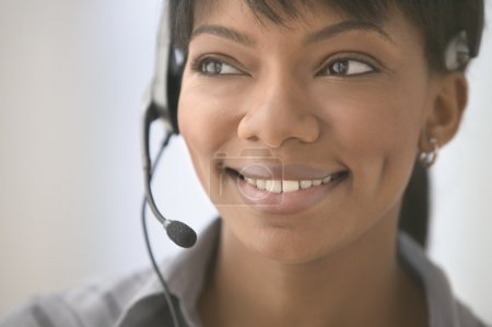 Young woman using headset