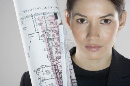 Woman holding drafting materials
