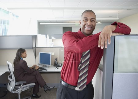 Businessman smiling for the camera in office space