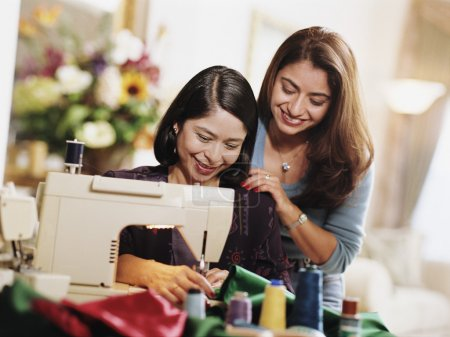 Mother and daughter working on sewing project