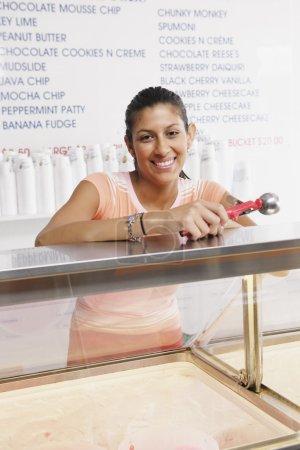 Teenage girl working in ice cream shop