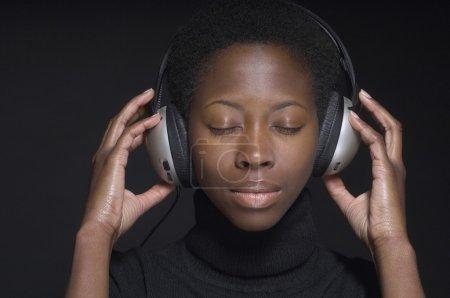 African woman wearing headphones