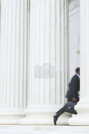 Blurred image of businessman running
