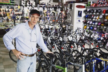 Man standing in bike shop