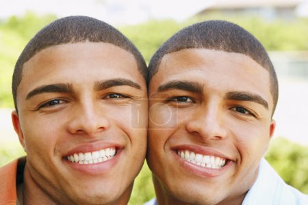 Hispanic twin brothers smiling