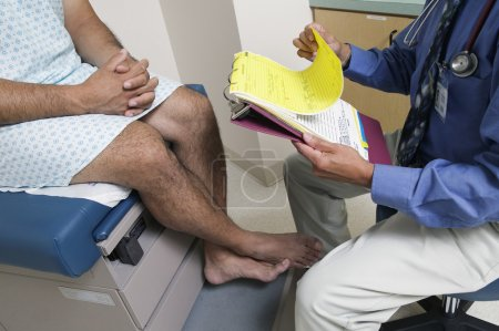 Male doctor with patient