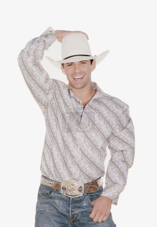 Man in cowboy hat smiling for the camera