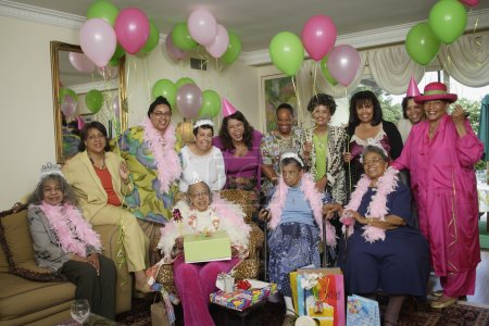 Senior adult birthday party with balloons