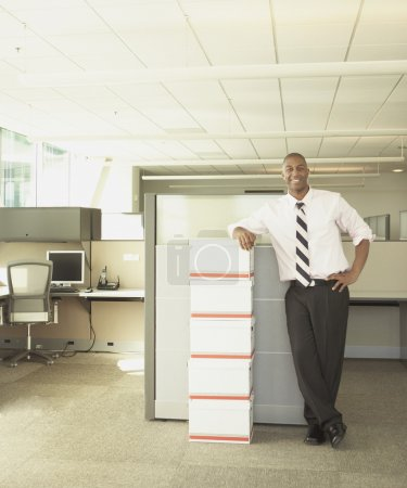 Businessman smiling for the camera in empty office space