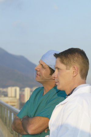 Two male doctors on balcony