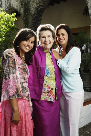 Three generations of women smiling for the camera