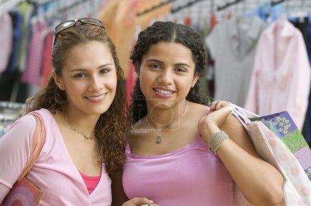 Two teenage girls shopping