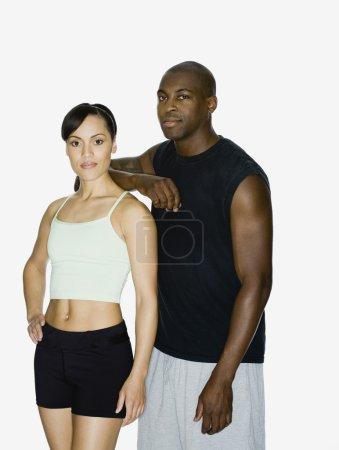 Multi-ethnic couple in athletic gear