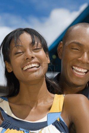 Hispanic couple laughing