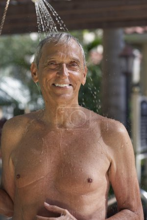 Senior man in outdoor shower