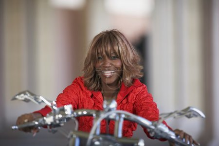 African woman on motorcycle