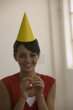 Young woman wearing party hat