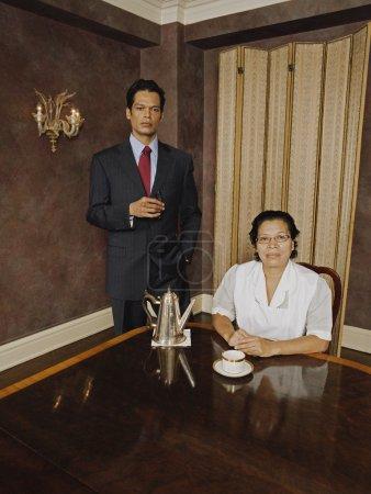 Hispanic businessman and maid