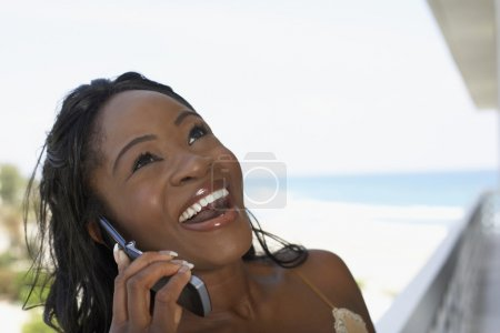 African American woman talking on cell phone