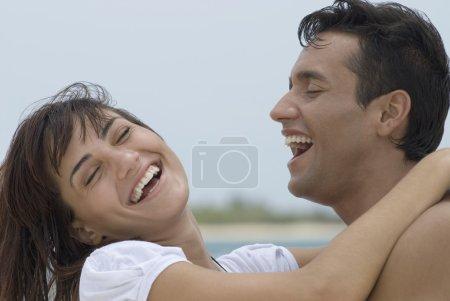 Multi-ethnic couple laughing