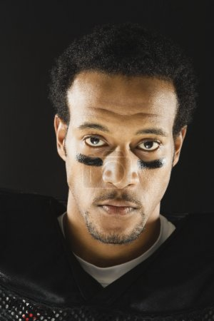 African American man wearing football uniform