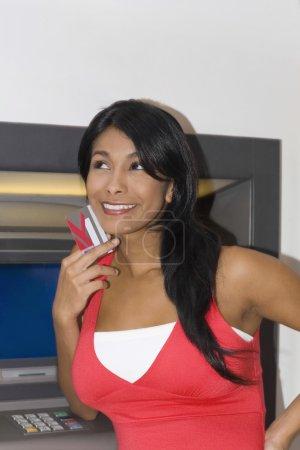 Hispanic woman holding credit card