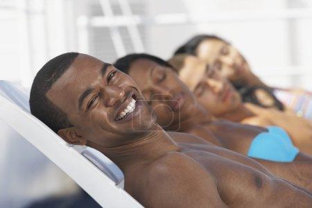 African American man sunbathing
