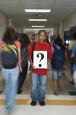 Student holding question mark sign