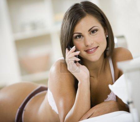 Woman in underwear talking on cell phone