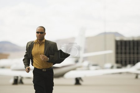 African man running from airplane