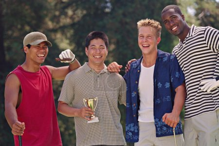 Multi-ethnic men with golf trophy