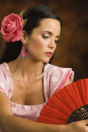 Hispanic woman wearing flower in hair